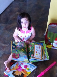 My daughter reading her new book
